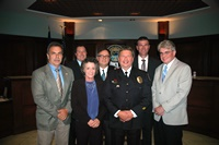 Board with City Manager and Police Chief