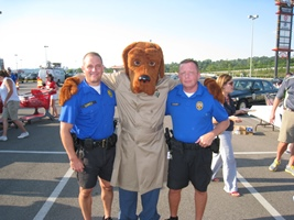 Police Officers with McGruff mascot at National Night Out 2013